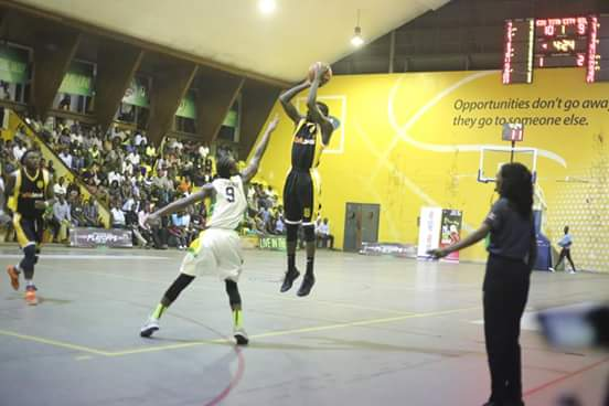 Oilers' Captain Jimmy Enabu lines up a three against KIU Titans on Tuesday night (Photo by FUBA medi)