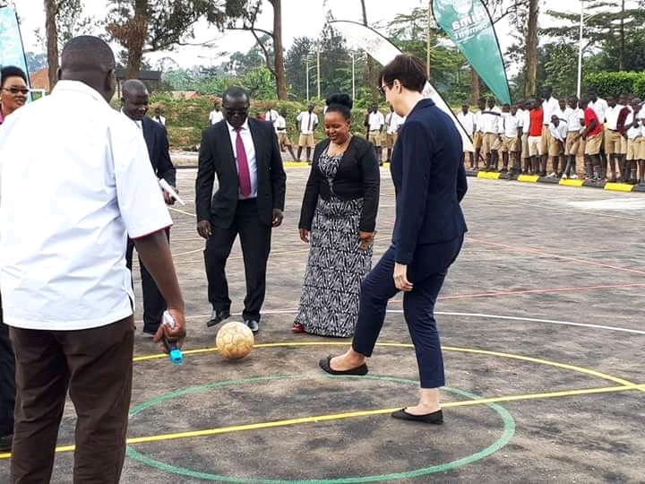 French Ambassador HE. Stephanie Rivoal (right)  kicks a ball at the hand-over (photo by Abraham Mutalyebwa)