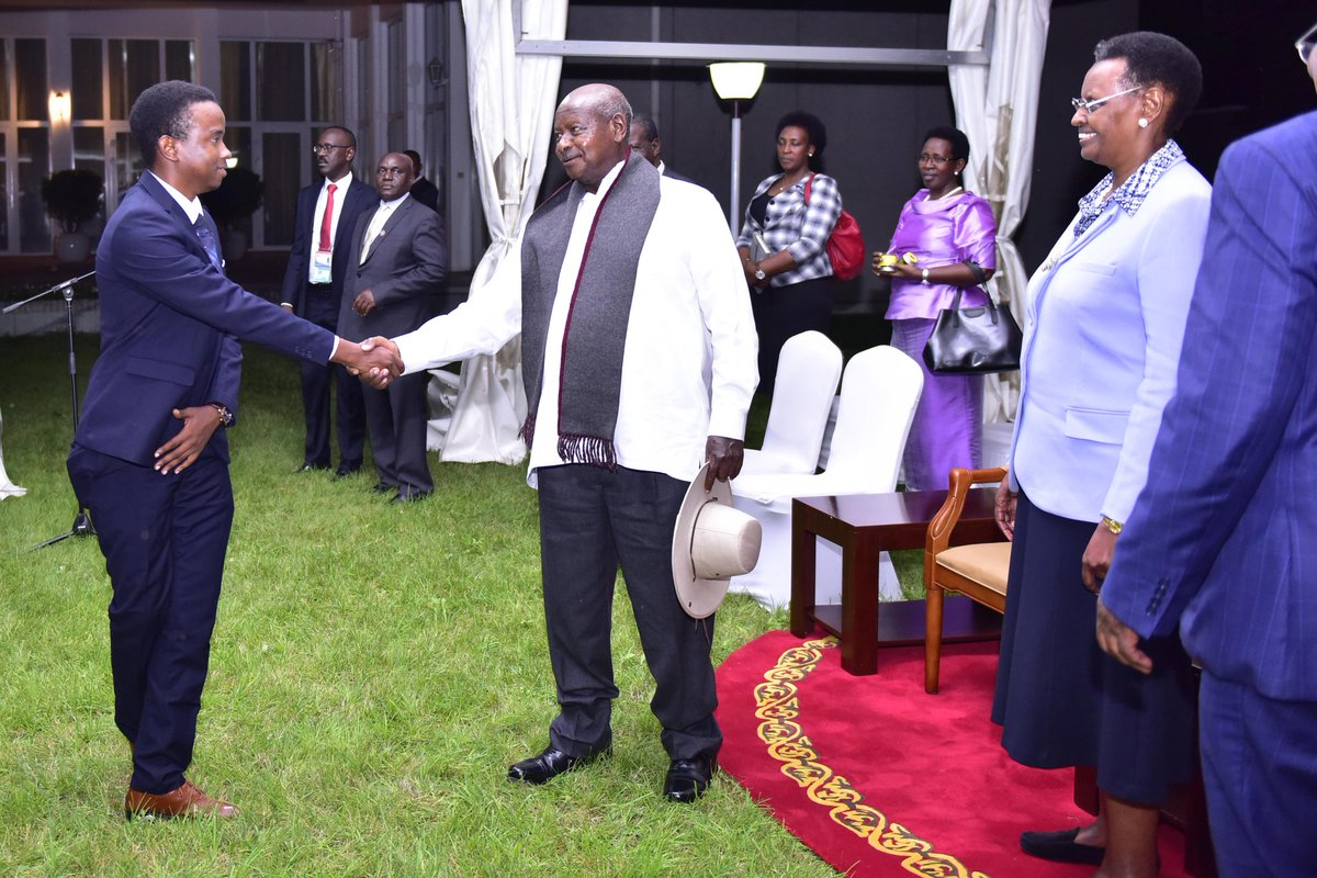 President Museveni congratulates a one, Ntumwa Birimumaso,  proprietor of Ubuntu Cafe, a company that exports Ugandan coffee to China (PPU PHOTO)
