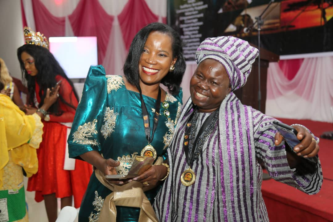 KCCA Ms Jennifer Musisi shares a light moment with one of the guests at the award (PML Daily PHOTO)