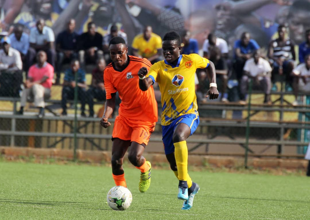 KCCA's Julius Poloto (right) was forced off early in the 2-1 win over Tooro United on Friday (Photo by Rachael Tebandeke)