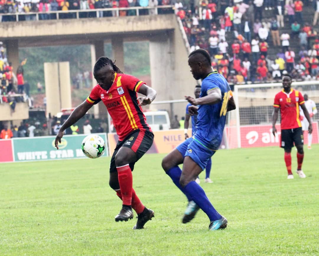 Hassan Wasswa (left) shields the ball away from Tanzania captain Mbwana Samatta during the goalless draw at Namboole