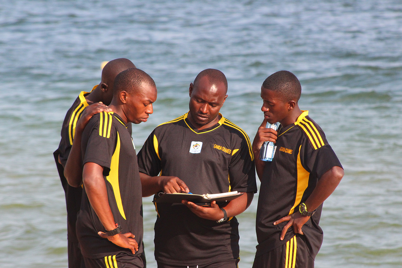 The Sand Cranes technical stuff sharing a few ideas during one of the recent training sessions (photo by FUFA Media)