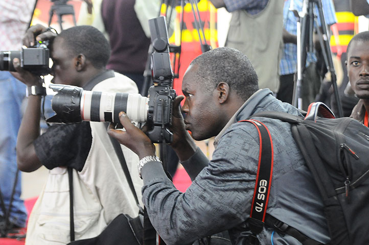 Journalists at work. Foreign journalists - seeking accreditation in Uganda, has decried the delay in the registration (FILE PHOTO)