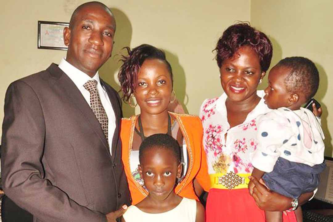The slain ex-DPC Buyende ASP Muhammad Kirumira and his family. His father has since received 25 children of the fallen Police officer as family opts for DNA screening (FILE PHOTO)