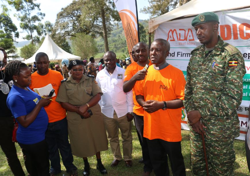 AMDA Chaplain Fr. Darius Magunda address the media alongside UPDF 2Division Spokesman Capt. Steve Akiiki and other Partners (PML Daily PHOTO)