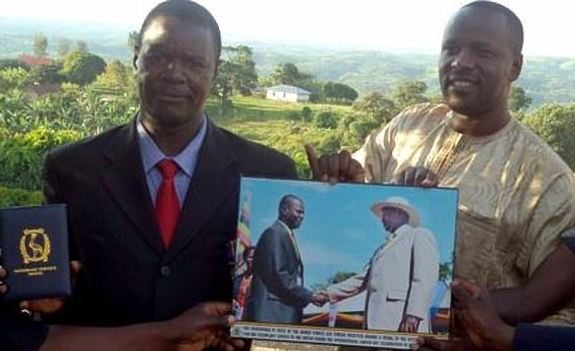 Mitooma RDC Mr Guma Nuwagaba (L) and his deputy Emmanuel Ngabirano posing with the medal and portratit he received on Labor Day. After losing to Naome Kabajju in the NRM primaries, the former Mitooma RDC has crossed to FDC (FILE PHOTO)