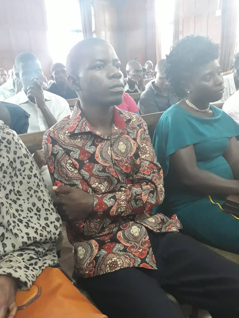 Brain Isiko with his sister at the high court waiting for the hearing of appeal challenging the 2 year jail term handed to him for stalking Kabarole district woman MP. (Photo by Racheal Agaba)