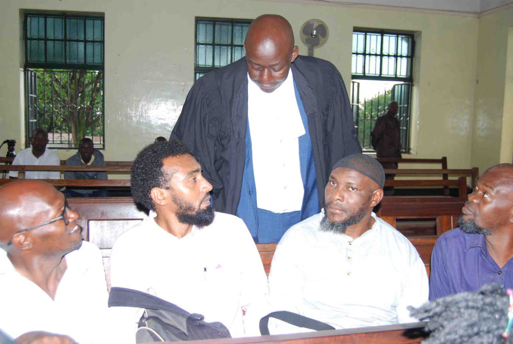 Seated are the 4 out of 5 suspects that were formerly freed by the High Court in 2016 on charges of detonating bombs in Kampala in 2010. They have newly been charged with terrorism. (Photo by Racheal Agaba)