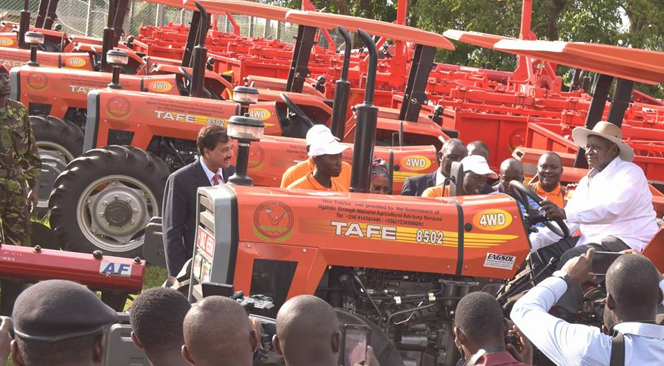 President Museveni hands over tractors during the launch of the distribution of tractors to farmers through Operation Wealth programme in Mbarara March 2017. (FILE PHOTO)