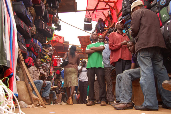Vendors at the entrance of St Balikuddembe Market in Kampala