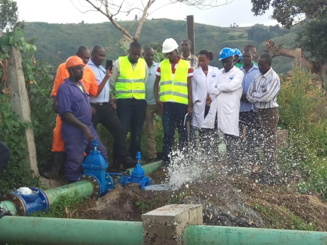 Dr. Eng. Silver Mugisha, the NWSC Managing Director (ectreme left) with other engineers testing the pipline water in Kapchorwa. (PML Daily Photo)