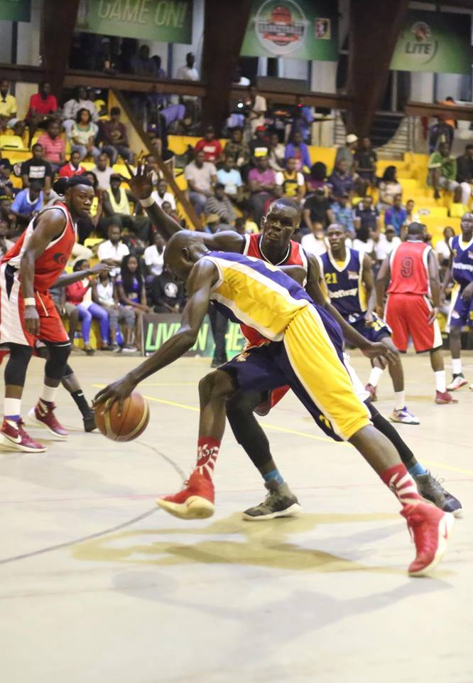 Power's Geoffrey Soro tries to dribble past James Okello on Sunday night (FUBA photo)