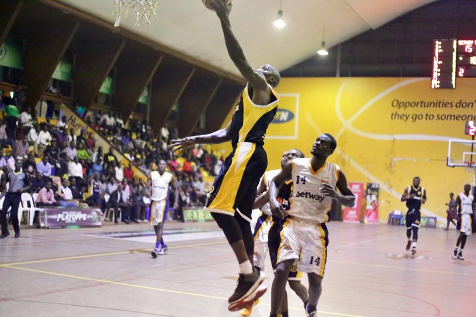 Omony sinks a lay up on Wednesday night as Power Captain, Joseph Ikong (14) looks on (Photo by FUBA Media)