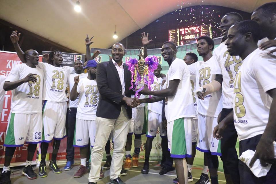 FUBA President Ambrose Tashobya hands Oilers Captain, Jimmy Enabu the league title on Wednesday night