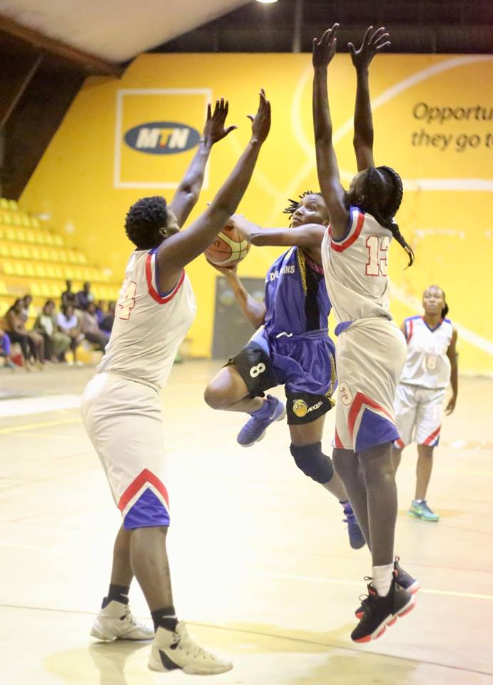 Imanishimwe (8) drives to they hope as UCU pair of Rose Akon (13) and Vilma Acheng (14)try to block her in game three (Photo by FUBA Media)