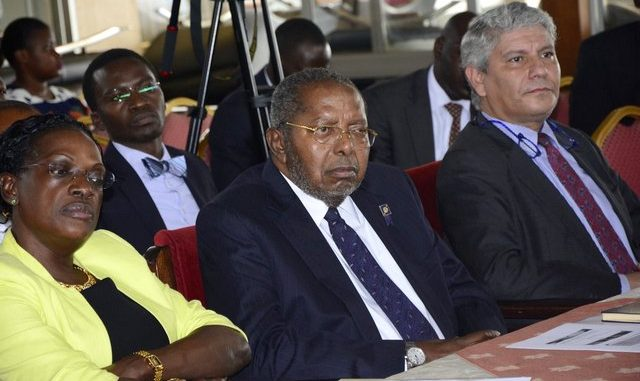 Emmanuel Tumusiime Mutebile, the Governor Bank of Uganda (Centre) with Justine Bagyenda, the former BoU Executive Director in charge of supervision at Parliament