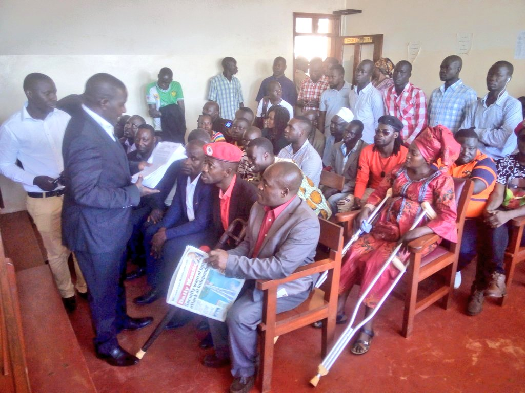 Defence lead counsel, Asuman Basalirwa speaks to Bobi Wine in Gulu Magistrates court. The Resident Judge has adjourned the trial to December 3, 2018. (PML Daily PHOTO)