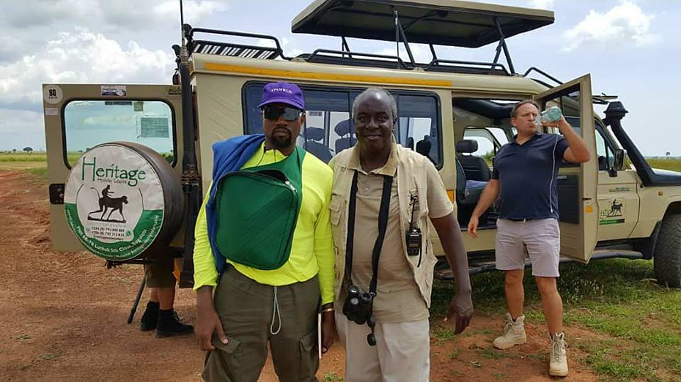 American rapper shares a pictorial moment with his official tour guide in Uganda, William Labolo. (FILE PHOTO)