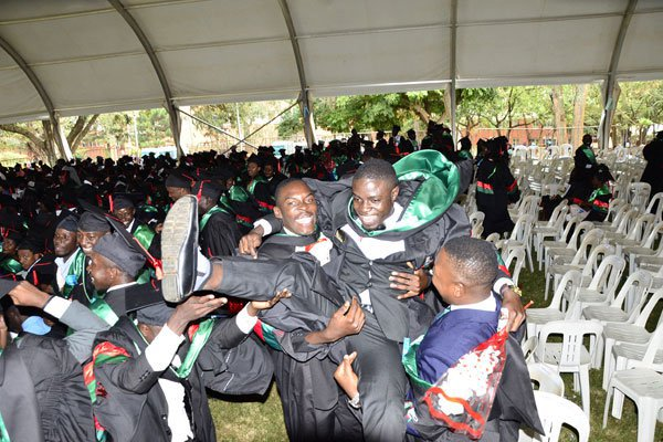 University of Kisubi graduands share a light moment during their just concluded graduation ceremony (PML Daily PHOTO)