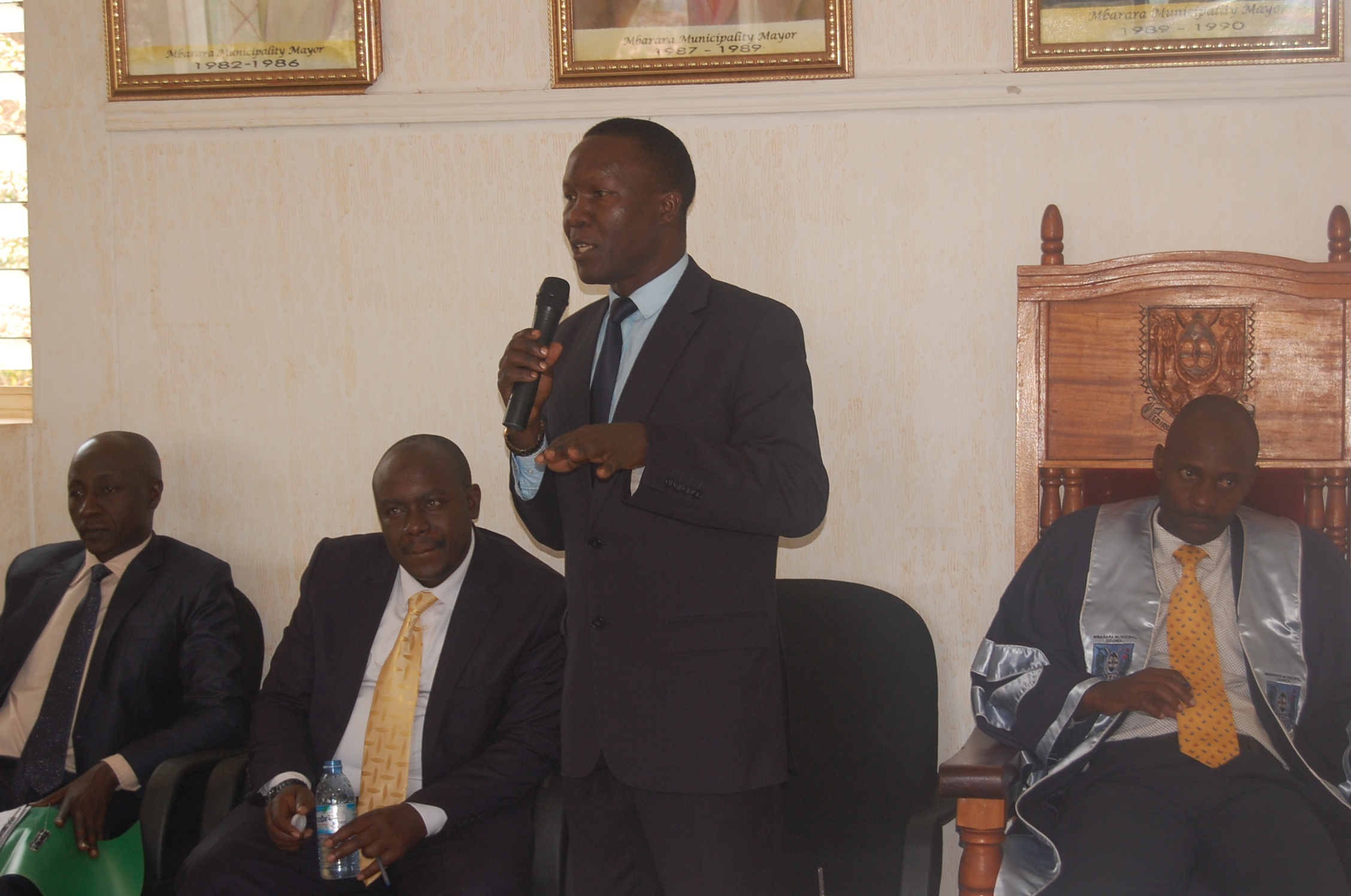 Edward Lwanga the town clerk Mbarara Municipality speaking in the council meeting last week, as Mayor Robert Kakyebezi and his executive committee look on (2)