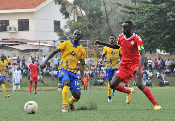 KCCA's Mike Mutyaba (left) in action against Kirinya on Tuesday (Photo by KCCA FC Media)