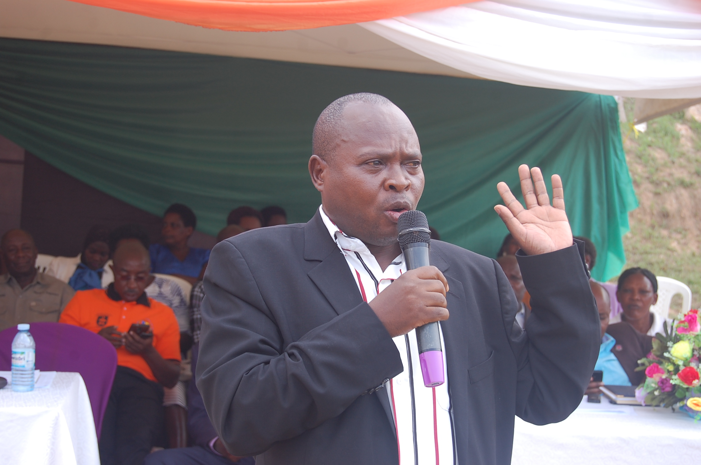 Gabriel Ahimbisibwe the DEO mbarara speaking at the teachers day celebrations (3)