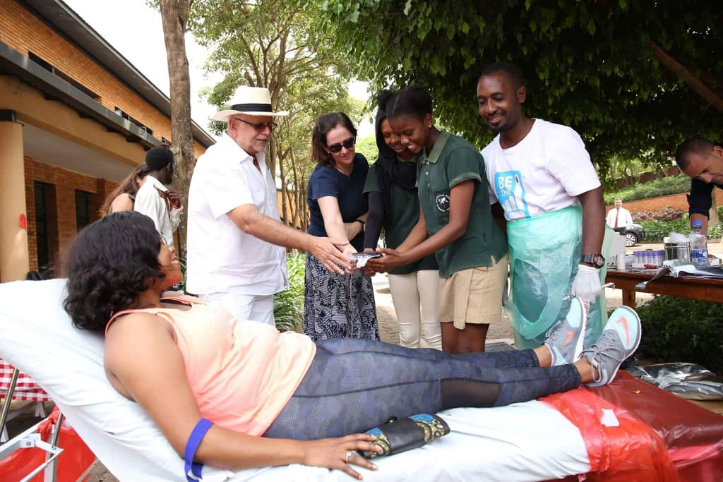 KISU proprietor and businessman, Sudhir Ruperalia receives a unit of blood as the donation drive took a high notch at the School on Saturday September 29 (PML Daily PHOTO)
