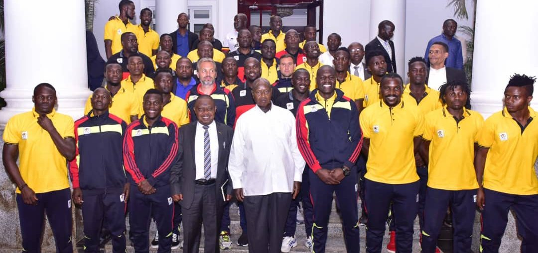 The Uganda Cranes pose for a picture with the President at State House, Entebbe on Tuesday (Photo by FUFA Media)