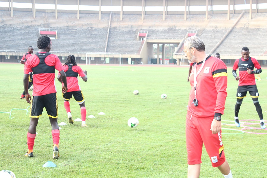 Lubega (16) and some of the other players during Monday's session at Namboole under the watch of coach, Sebastian Desabre (photo by FUFA Media)