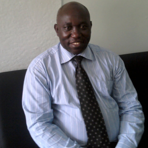 MUK Deputy principal of the College of Health Sciences, Dr. Isaac Okullo (above) and Dean have been demoted in a scandal at Uganda's top university (FILE PHOTO)