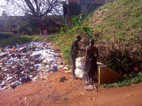 Shakul Mukasa and Peter collect boxes and recyclable bottles from areas of Makerere and Wandegeya; barely have a home (PHOTO BY JAVIRA)