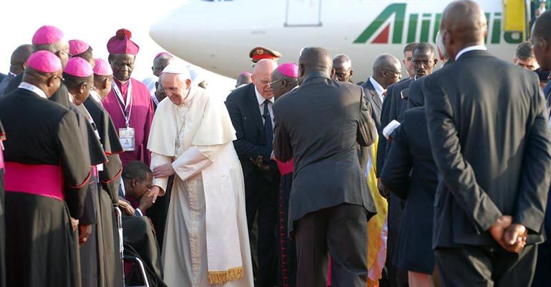 Pope Francis is welcomed by members of the clergy upon his last visit. He is set to return to Uganda (FILE PHOTO)