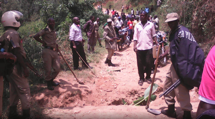 Police trying to calm down the angry residents over the damaged road in Ibanda district. (PML Daily Photo)