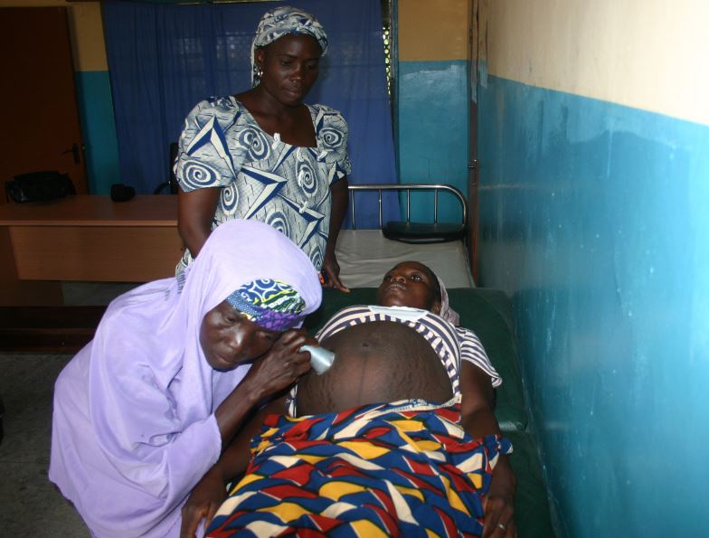A traditional midwife attends to an expectant woman (FILE PHOTO)