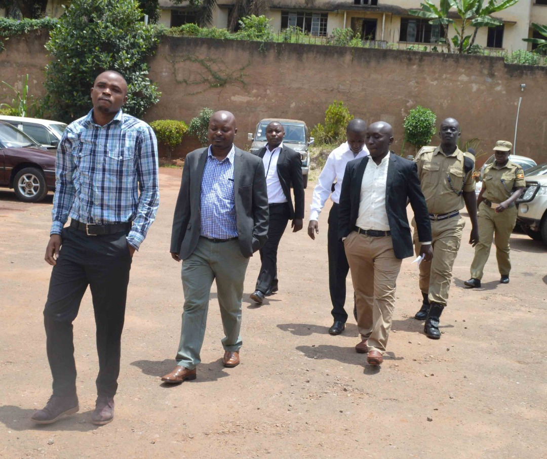 the police officers heading to the court cells before as they await to pay their bail cash.