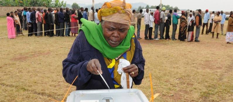 An elderly woman casts her vote during the 2016 General Elections February 2016. Govt is set to spend a whooping shs700bn in the forthcoming 2021 General Elections (FILE PHOTO)