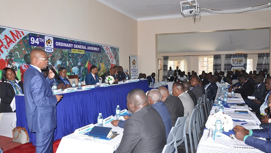 FUFA President Eng. Moses Magogo (left) speaking at the 94 General Assembly in Kabale (photo by FUFA media)