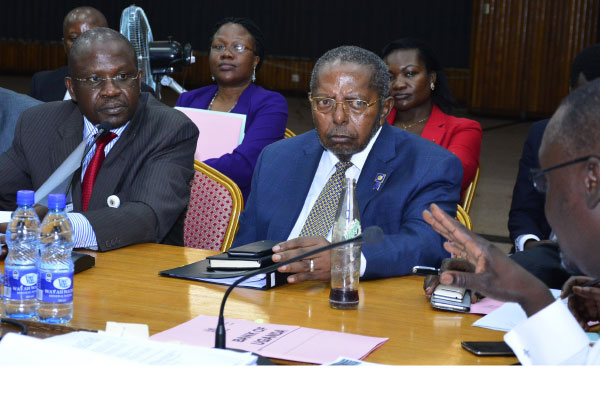 Bank of Uganda governor Emmanuel Tumusiime- Mutebile (2nd right) appears before Parliament. (FILE PHOTO)