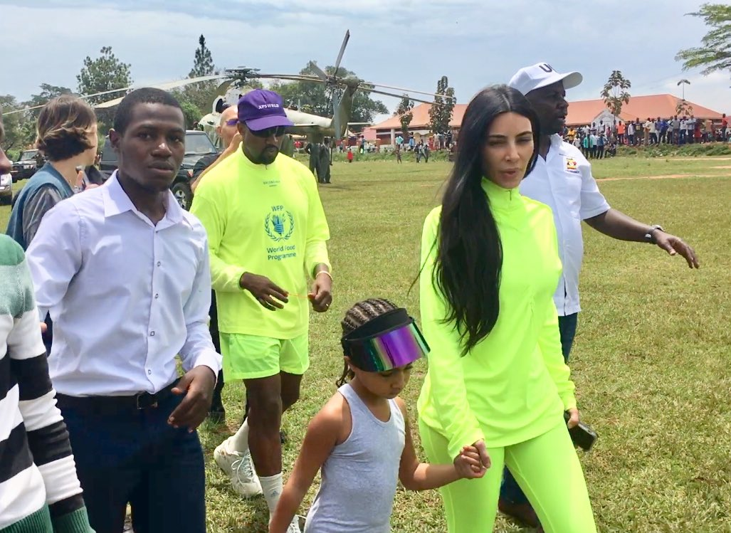 Minister of State for Tourism, Godfrey Kiwanda receives American rapper Kanye West (Ye), wife Kim Kardashian and their daughter, North West at Masulita in Kakiri on Tuesday October 16 (PML Daily PHOTO)
