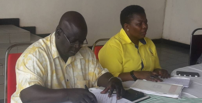 NRM's Director of Administration and Finance Dr. Hassan Wasswa Galiwango (L) with the Party's Secretary General Justine Kasule ...