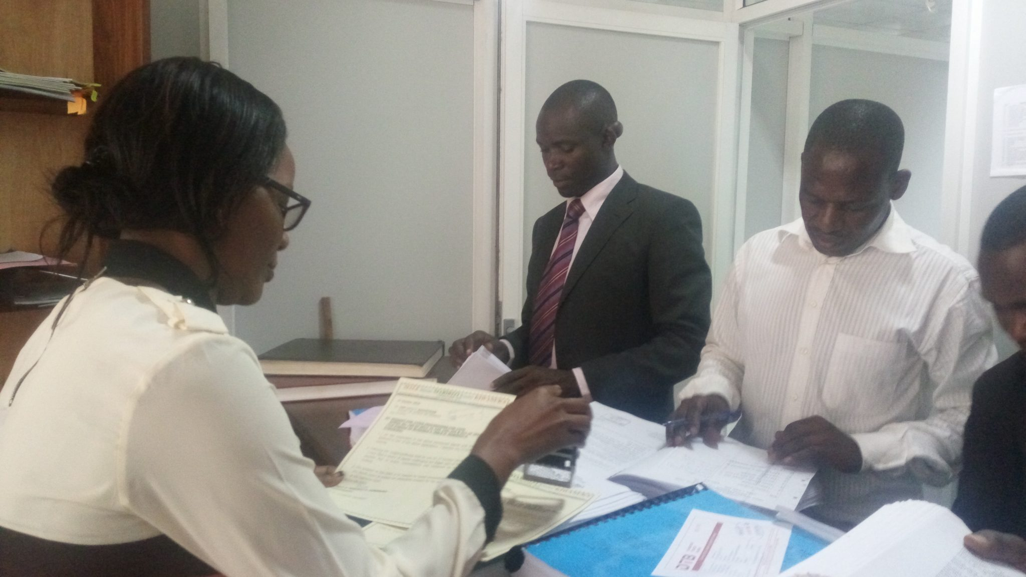 Mabirizi (in stripped tie)filing his notice of appeal at Court of Appeal Registry today