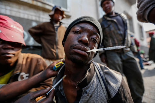 Youth inject themselves with several drugs. (FILE PHOTO)