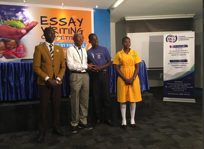 UCC Executive Director and the over all winners of the essay writing competition
