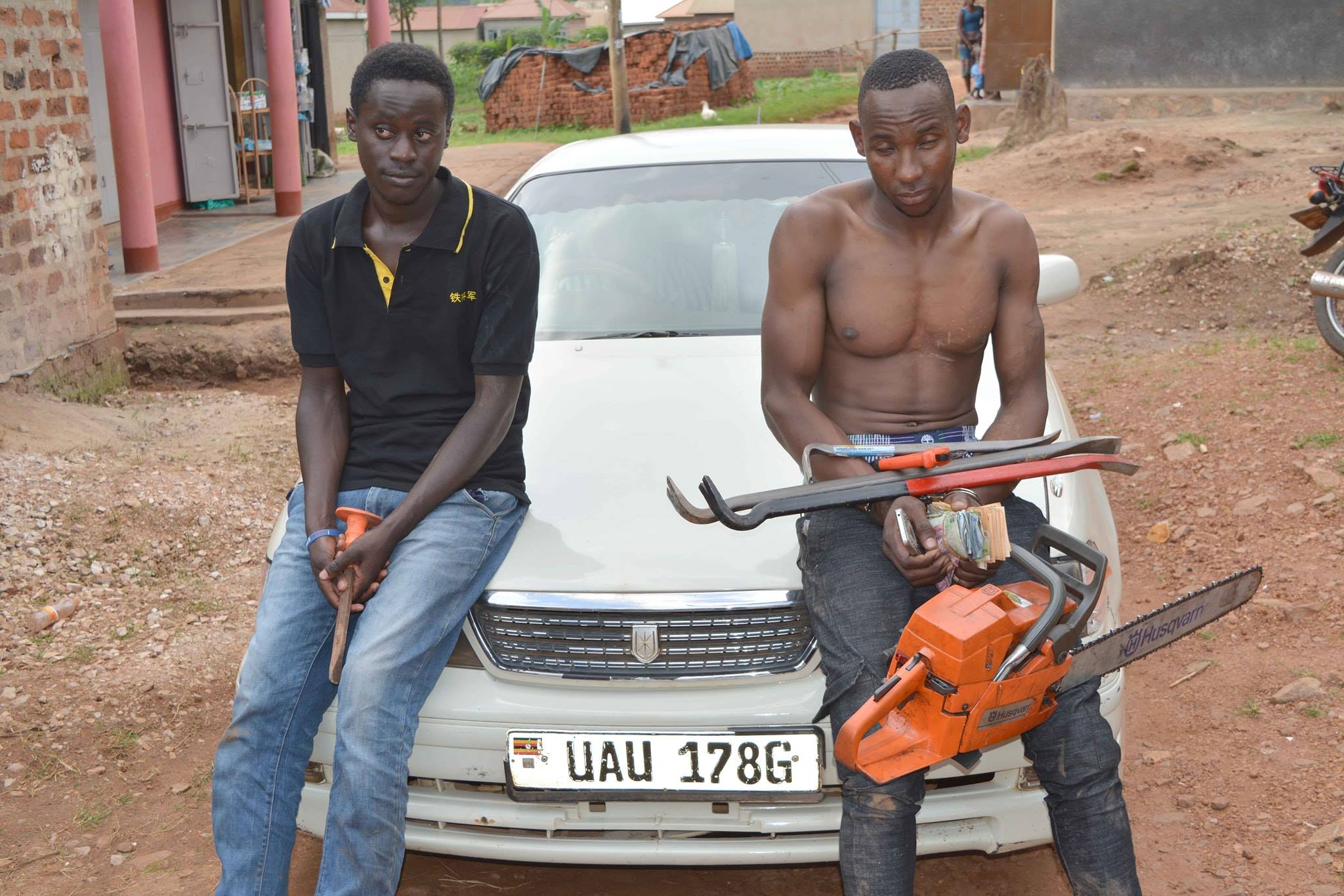 Police arrested suspects, Hakim Kigozi and his collegue Darius Atwine. Kigozi after they were found in possession of large sums of money suspected to have been stolen from the Indians, and other items (POLICE PHOTO)