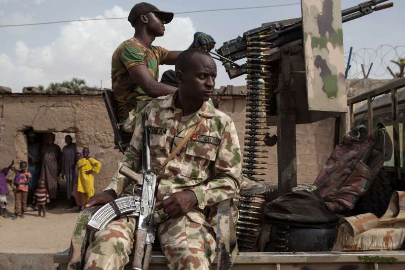 Nigerian soldiers patrol in the town of Banki in northeastern Nigeria. Govt forces foiled a Boko Haram attack S