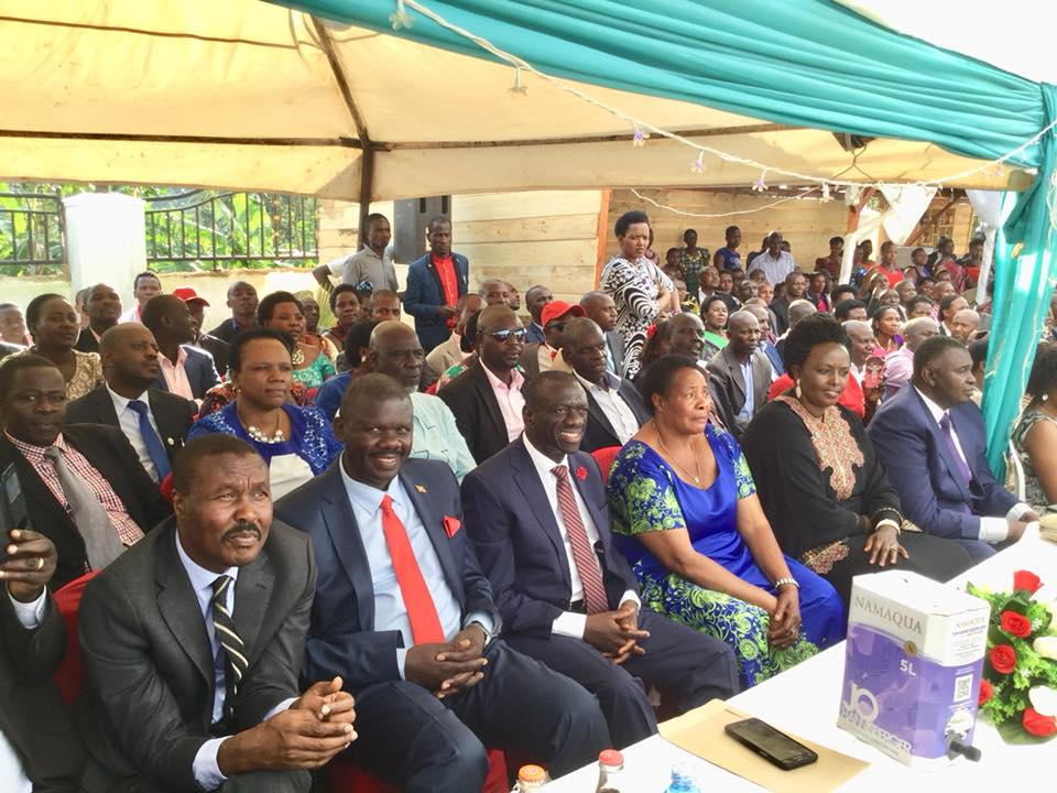Former FDC Party President Dr. Kiiza Besigye shares a table with New Formation vision bearer/lleader, Mugisha Muntu at a wedding ceremony of Rukungiri FDC mobiliser and businessman,