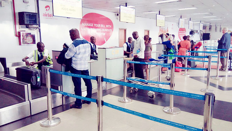Travellers check in at Entebbe International Airport. As Millions of Ugandans travel to and through Dubai every year, Dubai Airport authorities have unveiled stringent measures on the crackdown on drugsm, narcotics and smuggling (FILE PHOTO)