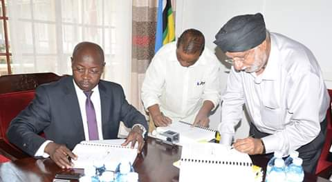 Agriculture MInistry PS Pius Wasajja signs off the contract to contract varous valley dams (PML Daily PHOTO)