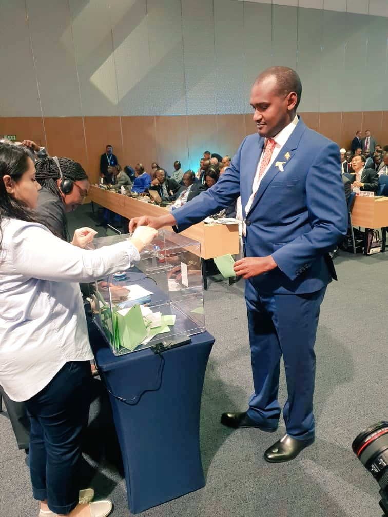 Head of Delegation to the PleniPot and ICT Minister,Hon. Frank Tumwebaze casts his vote for both ITU Council ? Radio Regulations Board #happeningnow at the Dubai World Trade Centre at the ongoing ITU Conference of Plenipotentiaries (UCC PHOTO)